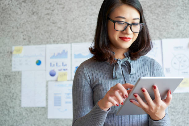 Woman using modern gadgets in work stock photo