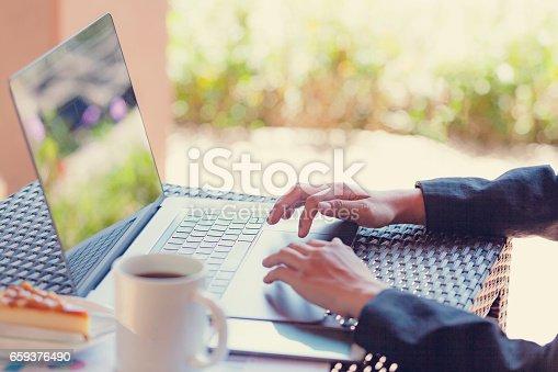 527033580istockphoto Woman Using modern Laptop Hand. 659376490