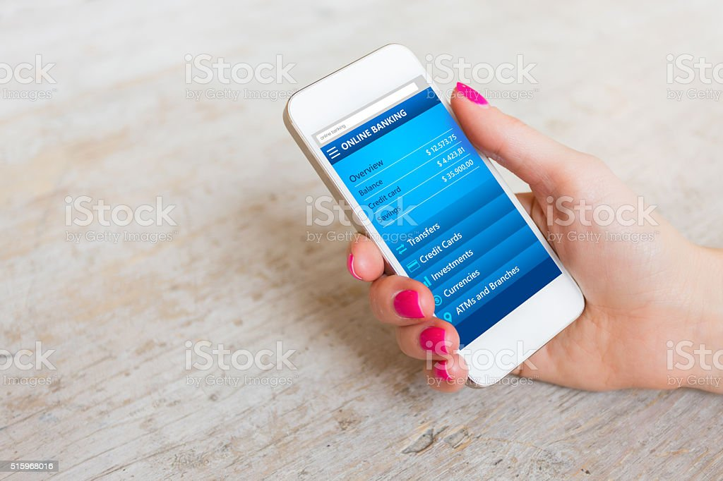 Woman using online banking website on smartphone stock photo