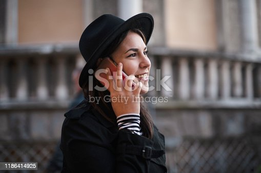694187664istockphoto Woman using phone 1186414925
