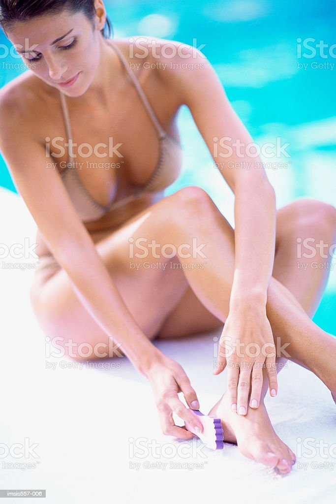 Woman using pummis stone royalty-free 스톡 사진