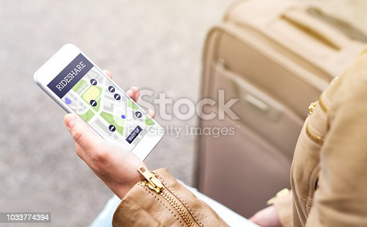 istock Woman using rideshare app. Ride share application in mobile phone. Commuter ordering taxi or carpool service with smartphone. 1033774394