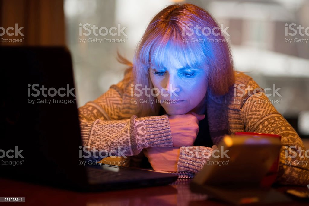 Woman Using Seasonal Affective Disorder (SAD) Light stock photo