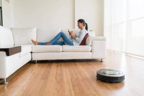 Woman using smart home technologies stock photo