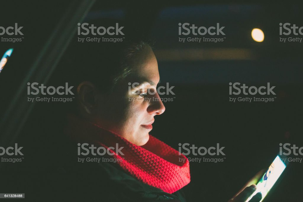 woman Using Smart Phone Car Inside stock photo