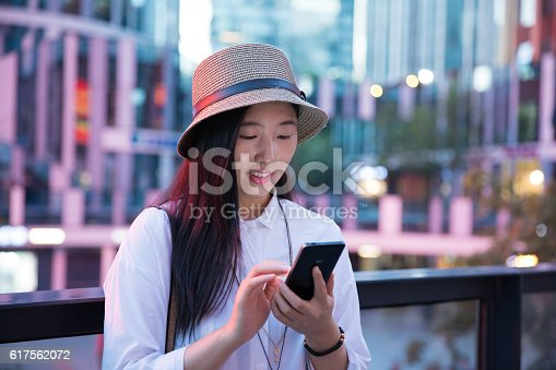 624206636 istock photo Woman using smart phone 617562072