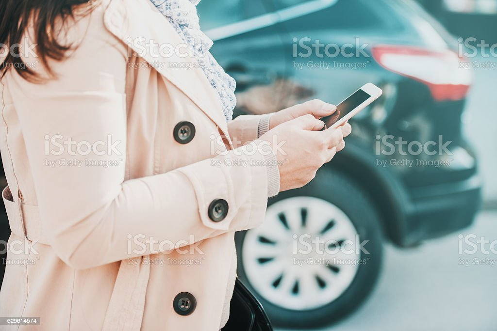 Woman using smart phone stock photo