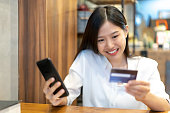 istock woman using smartphone and credit card. Shopping buying online 1134722140