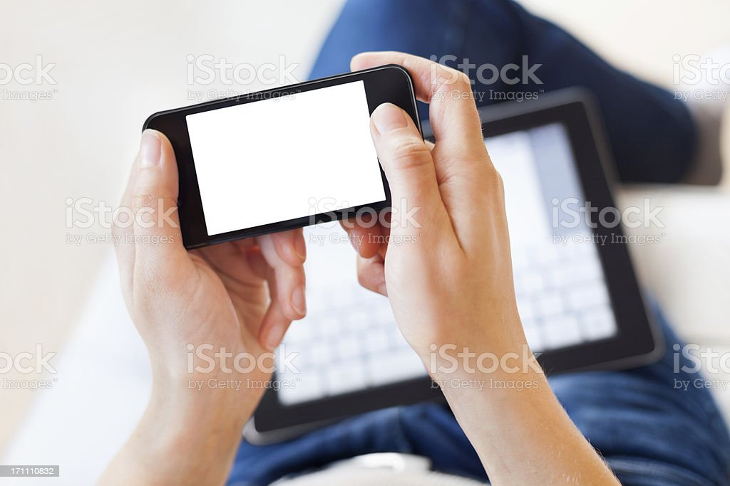 Woman Using Smartphone and Digital Tablet royalty-free stock photo