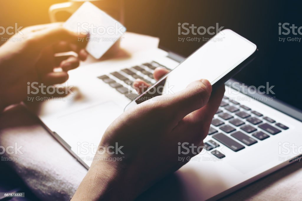 Woman using smartphone and login internet banking for shopping online. stock photo