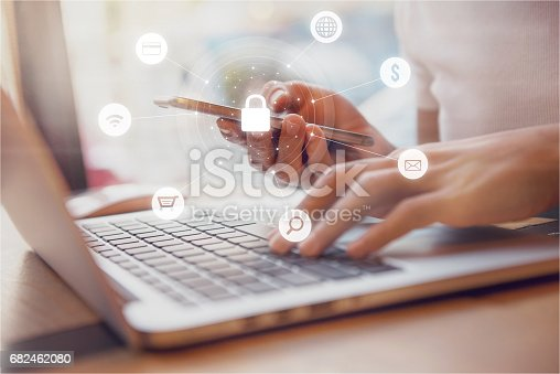 istock Woman using smartphone Cyber security network 682462080