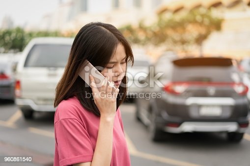 849721378istockphoto Woman using smartphone for the application on car blur background. Concepts for digital technology in everyday Life. 960861540