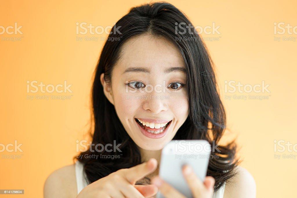 Woman using smartphone stock photo