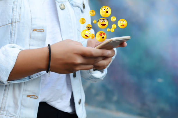 woman using smartphone sending emojis. - emoji foto e immagini stock