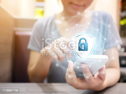istock Woman using smartphone with icon graphic cyber security network of connected devices and personal data information 1128907755