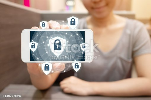 istock Woman using smartphone with icon graphic cyber security network of connected devices and personal data information 1145778626