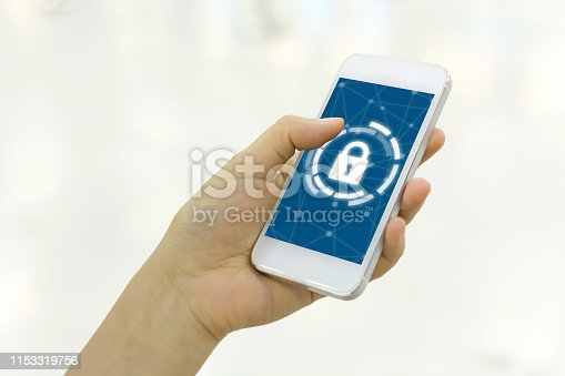 istock Woman using smartphone with icon graphic cyber security network of connected devices and personal data information 1153319756
