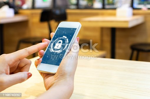 istock Woman using smartphone with icon graphic cyber security network of connected devices and personal data information 1168740257