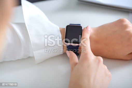 business woman using  smartwatch and working   in  office