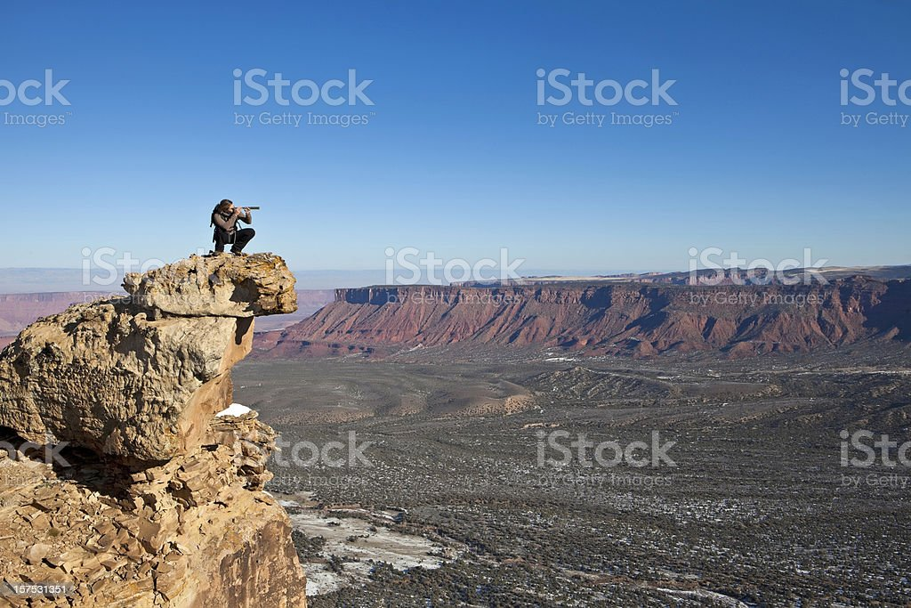 Woman using spotting scope royalty-free stock photo