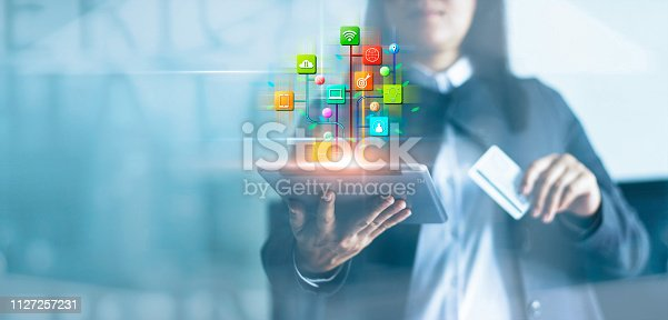 istock Woman using tablet and online payments, Digital marketing. Banking network. Online shopping and icon customer networking connection on virtual screen, Business technology concept 1127257231