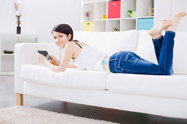Woman using tablet at home stock photo