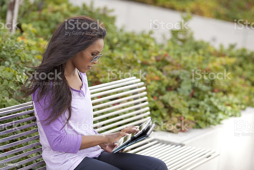 Woman using tablet computer outdoors. royalty-free stock photo
