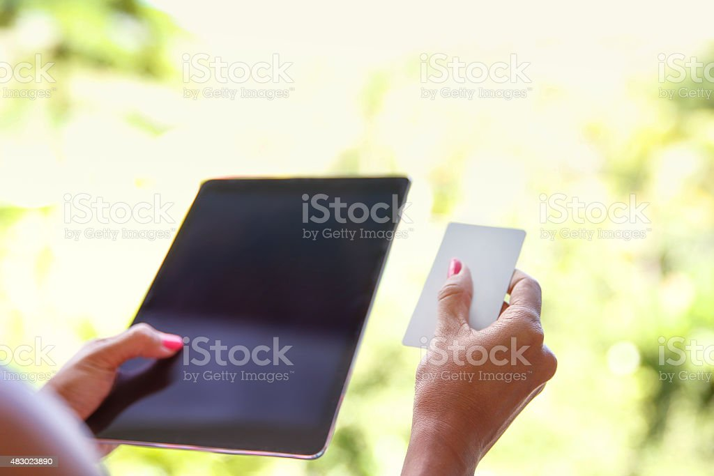 Woman using tablet in the outdoor stock photo