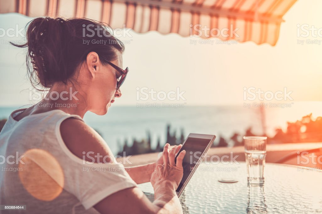 Woman using tablet stock photo