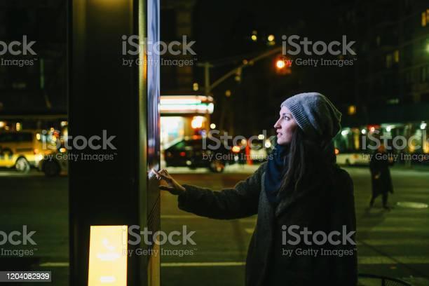 Woman using touch screen city display picture id1204082939?b=1&k=6&m=1204082939&s=612x612&h=smdcrbicej0tpdiwiesyjdihdwq7upwl 7cjc20 jw0=