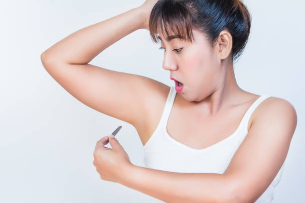 woman using tweezers and she plucking hairy armpits stock photo