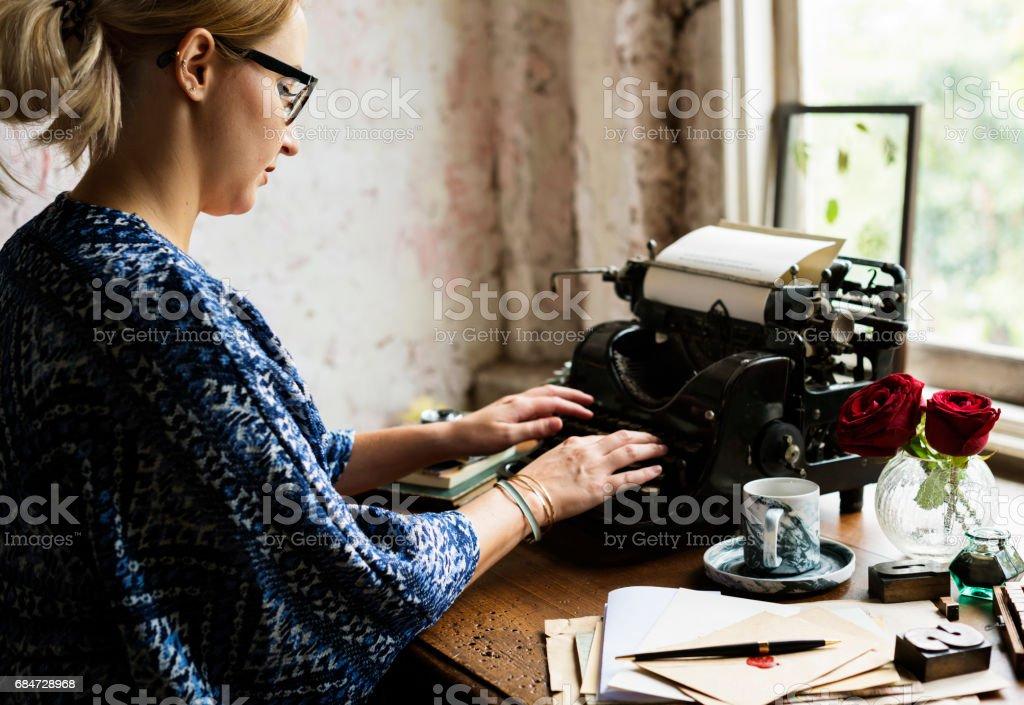 Woman Using Typing Retro Typewriter Machine Work Writer ロイヤリティフリーストックフォト