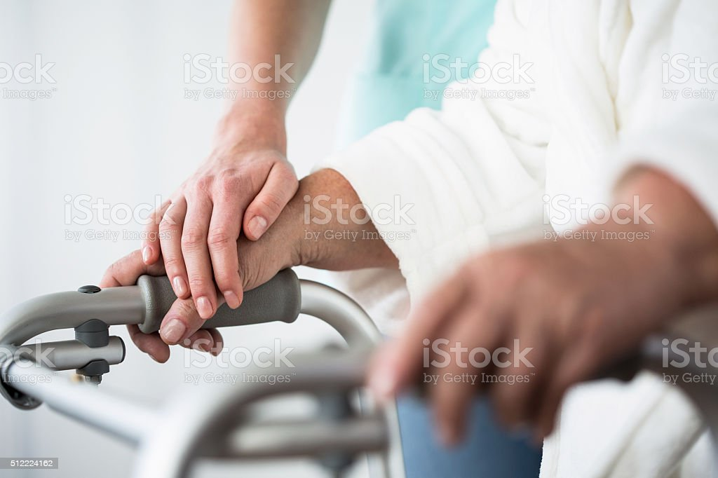 Woman using walking frame stock photo
