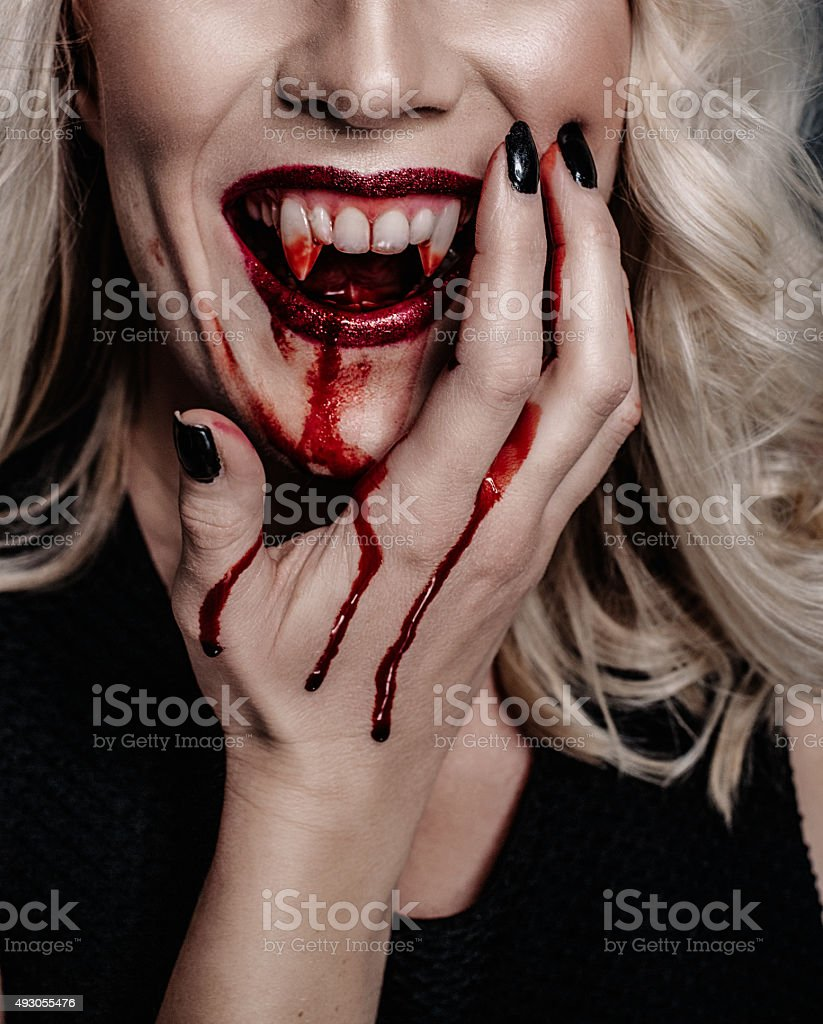 Woman vampire with scary blood for halloween stock photo