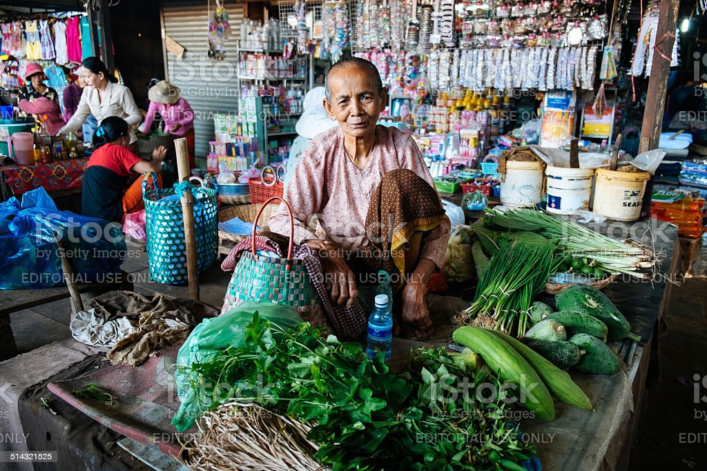 Woman vegetables seller in local market in Siem Reap, Cambodia stock photo