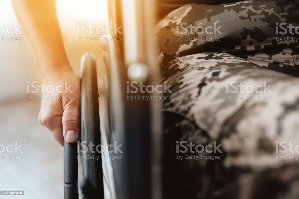Woman veteran in wheelchair returned from army. Close-up photo veteran woman in a wheelchair. stock photo