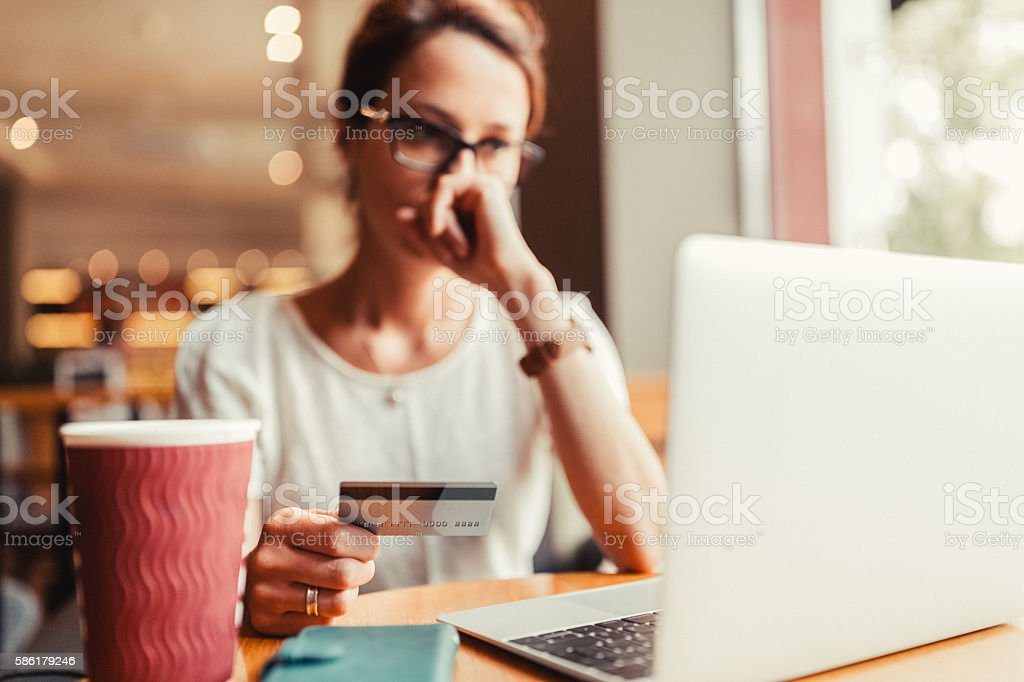 Woman victim of credt card fraud stock photo