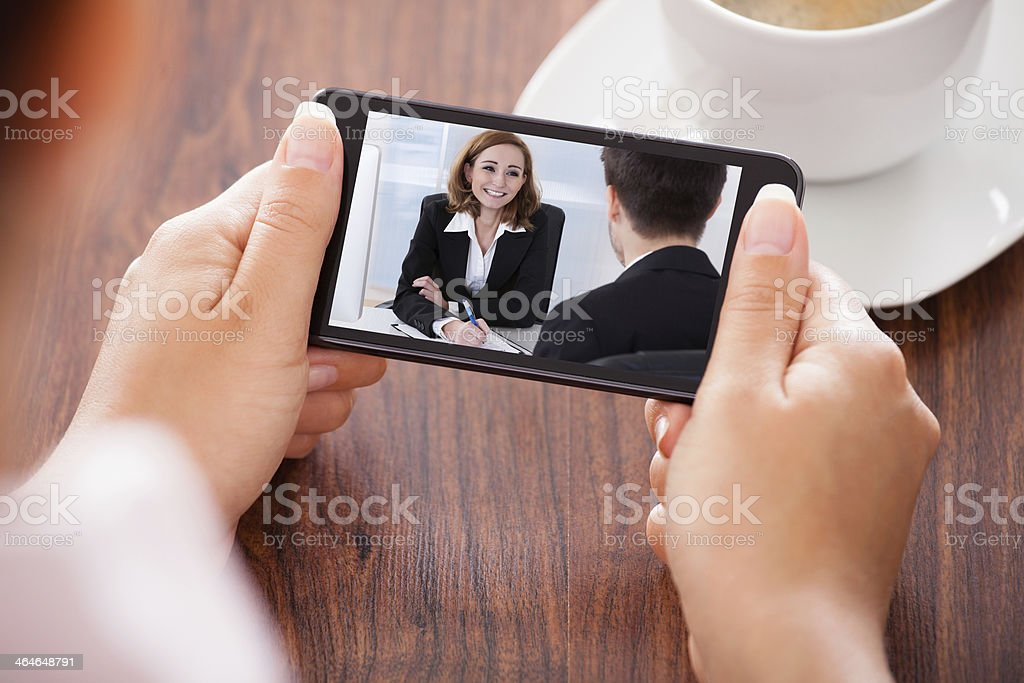 Woman Video Conferencing On Mobile Phone stock photo