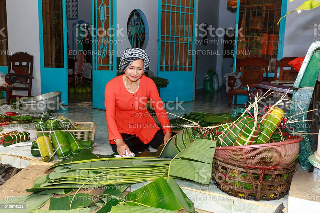 woman Vietnam is package tet cakes for Lunar New Year stock photo
