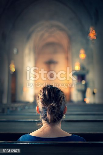 istock Woman visiting a christian church 522312675