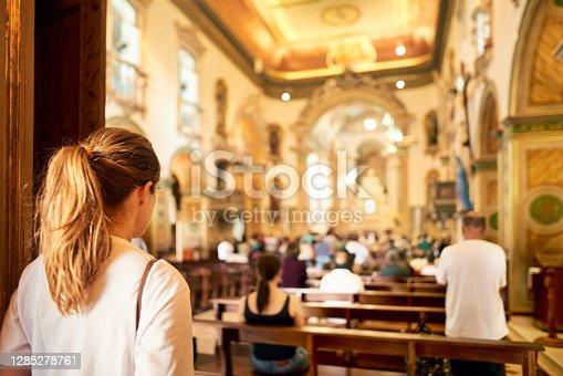 istock Woman visiting a church 1285278761