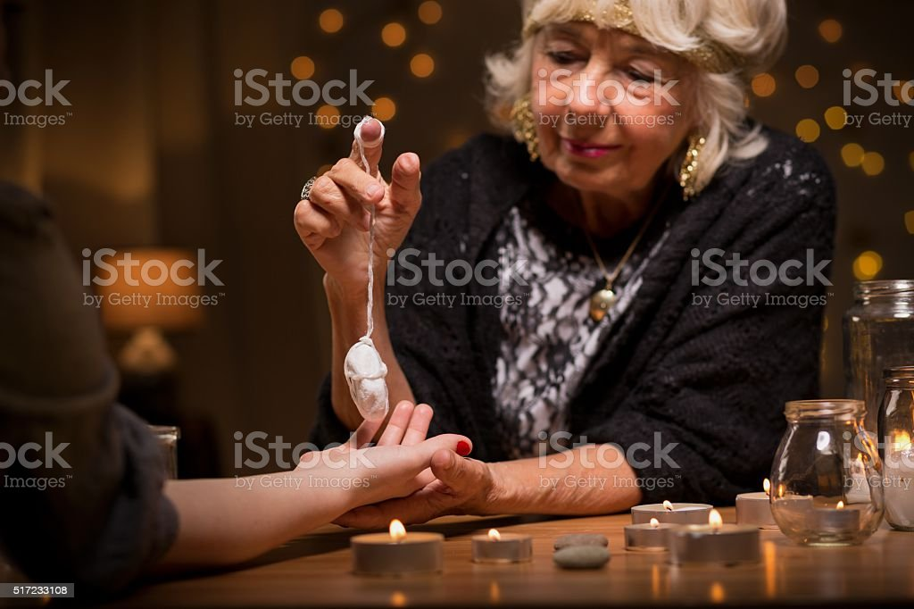 Woman visiting a fortune teller stock photo