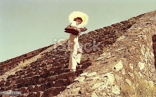 Vintage image of a Woman climbing an ancient Mexican ruin