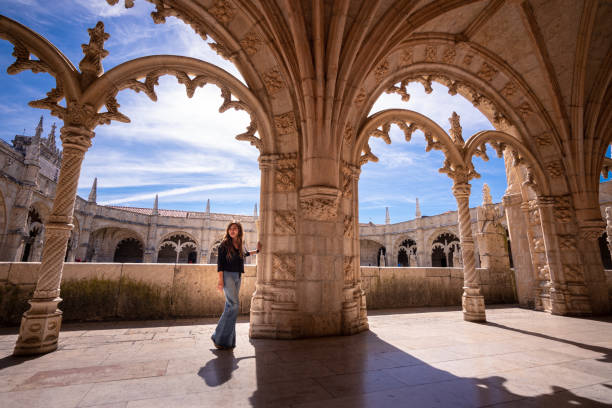 Woman visiting cloisters of Jeronimos Monastery in Lisbon, Portugal stock photo