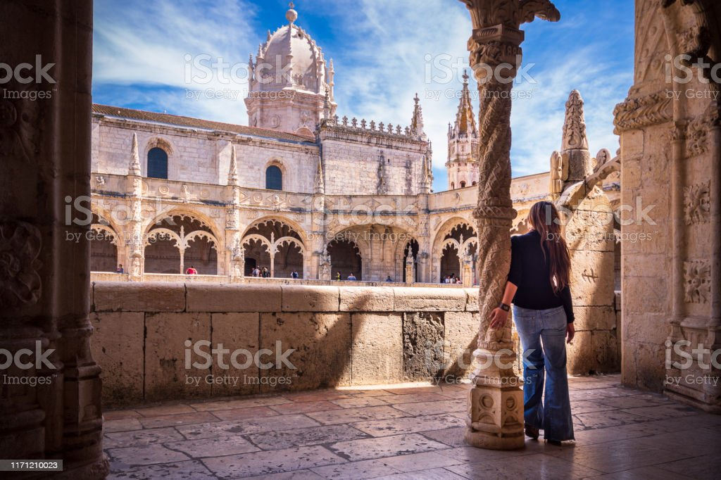 Woman visiting cloisters of Jeronimos Monastery in Lisbon, Portugal - Royalty-free Adult Stock Photo