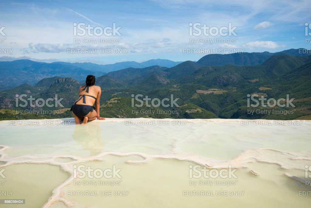 Woman visiting Hierve el Agua in Oaxaca State, Mexico stock photo