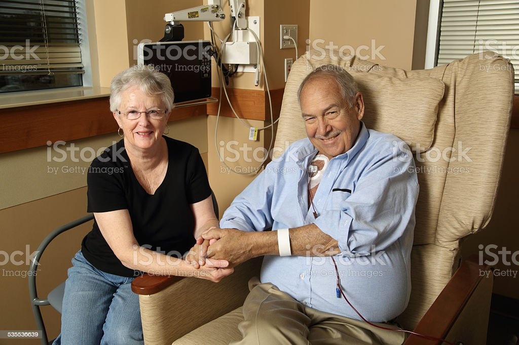 Woman Visits her Husband as he Receives Blood Transfusion stock photo