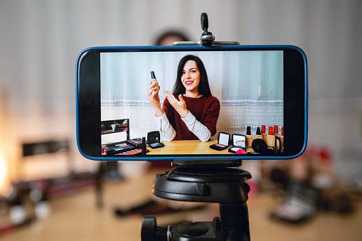 Woman vlogging about makeup