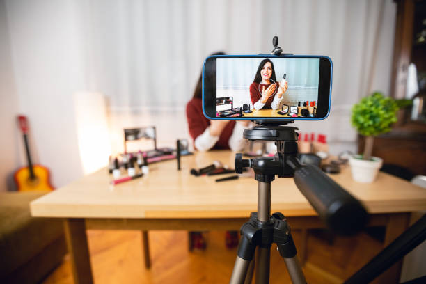 Woman vlogging about makeup stock photo