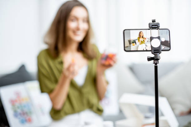 Woman vlogging about nutritional supplements stock photo